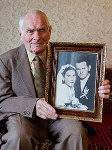 80-plus-near-centenarian-man-holding-wedding-photo