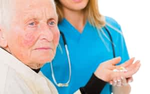 sad-elderly-woman-taking-pills-min